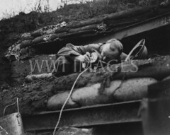 WWI0037B1 (ww1images) Tags: light lamp concrete soldier wire post steel brodie watch helmet cable spot bunker british sight shelter dugout officer sandbag observer signalling reinforcement allied messtin