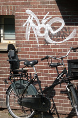 2011.04 - 'Urban still-life: parked bicycle in sun-light of Spring', in front of a brick wall with a graffiti tag; geotag free urban picture, in public domain / Commons CCO;  city photography by Fons Heijnsbroek, The Netherlands (Amsterdam photos, pictures, foto's - Netherlands) Tags: city sunlight brick amsterdam bicycle wall graffiti 2011