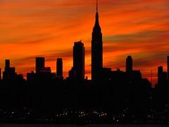 Midtown Sunrise 11/20 2 (quiggyt4) Tags: nyc newyorkcity red orange sun ny newyork yellow skyline skyscraper sunrise dawn newjersey glare horizon nj midtown esb hudsonriver empirestatebuilding wtc hudson gothamist timewarnercenter weehawken hudsoncounty ronpaul freedomtower ows occupy 5photosaday 1wtc hudsoncountynj occupywallstreet
