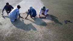 Pitch cleaner (Raja Islam) Tags: pakistan men work state working bank ground cricket cleaning clean pitch cleaner karachi chappal