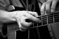 Finger Style (Leanne Boulton) Tags: life street city people urban blackandwhite bw musician music white abstract black monochrome up field closeup composition canon mono scotland blackwhite hands focus artist dof hand close bokeh guitar glasgow finger candid fingers style scene musical human sound instrument string strings bandw performer fret depth fretboard