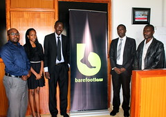 The Barefoot Law team receive about 50 queries a day via social media platforms, Skype, email, phone and SMS, mostly from people they never met in person, on a variety of issues. To the far right is client Anthony Latim. Credit: Amy Fallon/IPS (IPS Inter Press Service) Tags: africa gerald barefoot law uganda services legal abila