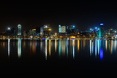 Water Mirror (CResende) Tags: light color reflection water night buildings mirror bay glare progress calm citycenter angola luanda cresende