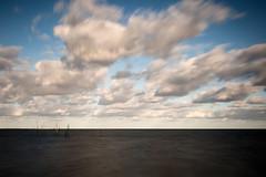 14 Poles (frank_bunnik) Tags: longexposure sea seascape beach netherlands clouds canon poles hellevoetsluis fishingpoles canontse45mm leefilters canontse leebigstopper frankbunnik