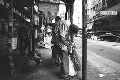 - (PatrickYHC) Tags: leica city portrait people blackandwhite bw hongkong candid citylife streetphotography rangefinder shamshuipo voigtlander15mm leicam8 voigtlander15mmsuperwideheliar