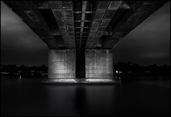 Bridge_Over_Silvered_Water_01 (Beetwo77) Tags: longexposure urban night silver industrial fuji nocturnal shell oil nik pancake 1855mm refinery silverwater 14mm 27mm efex xe2 vision:text=0547 vision:sky=0917 vision:outdoor=0664