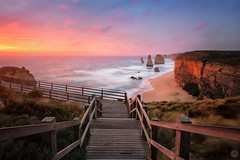 Sunset at the Twelve Apostles (Luke Tscharke) Tags: light sunset red canon geotagged glow australia wideangle victoria lookout cliffs greatoceanroad twelveapostles aus seastacks portcampbell 1740l princetown 5d3 5dmarkiii geo:lat=386639900779443 geo:lon=1431041657924652