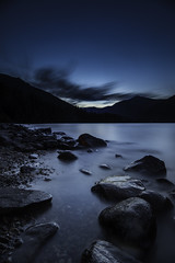 {Before the Stars} (Lyndsay Esson) Tags: longexposure blue lake water twilight rocks bluehour revelstoke canadianlandscape threevalleygap explorebc canadiancreatives