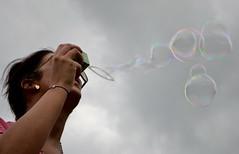 bubbles (Vic 2205) Tags: york friends cloud motion colour clouds contrast fun happy grey movement nikon friend angle cloudy shapes bubbles blow lookup celebration sphere bubble shape celebrate goodtimes spherical inmotion capturethemoment d3100 nikond3100