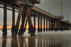 Sunblock and Stars (RichGreenePhotography.com) Tags: longexposure sunset sky sun fall beach water clouds reflections grey pier surf gloomy cloudy perspective pacificocean venicebeach pilings mussels stark deserted 317 venicecalifornia venicepier wintercoming 5873 5874 nikond7000 richgreenephotography nikkor18300mmf35