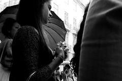 Waiting for the rain to stop (t3mujin) Tags: street city autumn bw fall portugal girl rain weather umbrella season europe lisboa lisbon pt joaoalmeidaoctoberportfolio