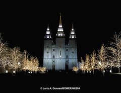 Mormon Temple at Night during Christmas Season (Bower Media) Tags: christmas trees red silhouette angel night temple lights utah colorful saltlakecity mormon lds moroni latterdaysaints horseandbuggy larrydonoso larryadonoso photo©larryadonoso