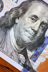 The new vs. the old American 100 dollar bill (Symbiosis) Tags: money benjaminfranklin currency watermark wealth blueribbon moneyclip oldversusnew 100dollarbill unitedstatestreasury securityfeatures thenewlydesigned100billcomparedtotheold100bill