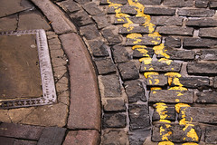 Square in the Circle (Wilamoyo) Tags: road street old abstract lines tarmac yellow stone curves hard double cobbled sidewalk hull asphalt curb tonal concreate