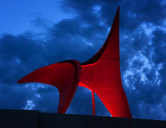 Eagle (Gabriel Tompkins) Tags: seattle blue sunset red sky urban sculpture usa sun art metal night clouds contrast washington twilight nikon cloudy dusk metallic dramatic bluesky curvy belltown pacificnorthwest publicart bluehour nikkor curve washingtonstate pnw 2009 emeraldcity gloaming curvaceous 18105 alexandercalder theeagle electriclights olympicsculpturepark d90 18105mm nikond90 18105mmf3556gvr tronam gabrieltompkins tronamcom