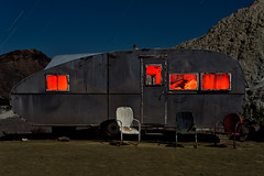 trailer life. eldorado canyon, nv. 2016. (eyetwist) Tags: eyetwistkevinballuff eyetwist night trailer camper derelict teardrop vintage rusty techatticupmine eldoradocanyon nelson nevada abandoned ruins dark longexposure long exposure fullmoon desert nikon d7000 nikkor capturenx2 npy nocturne highdesert americana americantypology american typology dead desolate lonely decay nv wideangle shadow mojavedesert ruin lightpainting old rust southwest startrails star trails techatticup mine ghosttown touristtrap coloradoriver patina chrome dented chairs red streamlined windows door 18200mmf3556gvr 18200mm
