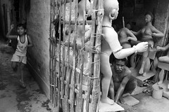 Work and play (Rajib Singha) Tags: travel street people portrait children work play monochrome idol art interestingness flickriver nikond7200 kumartuli kolkata westbengal india