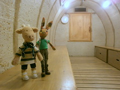 Beulah and Georgia in an air raid shelter, Docklands Museum 20 May 13 (Castaway in Scotland) Tags: england rabbit london toy hare olympus giraffe jellycat d700