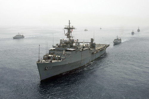 USS Ponce leads a formation of ships.