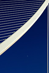 the moon and calatrava - part 2 (valencia, spain) (bloodybee) Tags: street bridge blue sky españa moon white detail valencia lines architecture design spain europe steel minimal half minimalism suspensionbridge santiagocalatrava comunidadvalenciana daymoon cityofartsandsciences ciutatdelesartsilesciències pontdelassutdelor