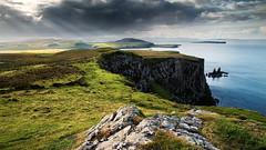 Skye (Youronas) Tags: ocean greatbritain cliff sun seascape skye nature rock clouds canon landscape coast scotland rocks natur rocky cliffs 7d coastline sunrays landschaft sunray schottland 1585 canon7d canon1585
