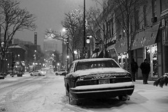 Sunday night (local paparazzi (isthmusportrait.com)) Tags: road street city autumn winter light blackandwhite bw white black cold building fall cars car architecture night canon dark outdoors snowflakes eos 50mm prime evening pod lowlight downtown traffic snowy f14 candid stage grain snowstorm citylife streetphotography fluffy first windy capitol dome handheld delivery chilly snowing plates usm madisonwi noise firstsnow rotunda snowfall venue blizzard frigid statestreet ef afterdark iso1600 snowcovered blustery pizzadiroma isthmus 2013 50mmf14usm orphuem danecountywisconsin photoshopelements7 canon5dmarkii pse7 localpaparazzi redskyrocketman lopaps vision:car=0568 vision:street=0614 vision:outdoor=0961 winterstormdion