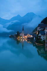 Hallstatt in the Cloudy Morning (Vertical Image) (baddoguy) Tags: city morning light mountain lake reflection church nature water vertical fog landscape outdoors photography austria town twilight europe day village hill nopeople tourist unescoworldheritagesite unesco cleaning copyspace oldtown iconic scenics centraleurope salzkammergut unusualangle hallstatt upperaustria gmunden cloudsky traveldestinations colorimage physicalactivity famousplace beautyinnature lanmark internationallandmark traveldestination touristresort austrianculture europeanalps