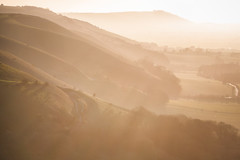 (drfugo) Tags: trees sunset england grass downs landscape sussex spring haze brighton south hills hazy devilsdyke canonef135mmf2lusm fulkingescarpment canon5dmkii