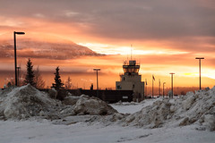 Fire in the Sky (yukonchris) Tags: morning winter cloud mountain snow canada beauty landscape dawn airport north lamppost yukon northern whitehorse sunup fireinthesky controltower aerodrome northof60 greymountain yxy southernyukon canyonmountain redskyinmorning canon7d efs1585mm eriknielsenwhitehorseinternationalairport