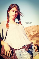 Desert Maiden (Kelly McCarthy Photography) Tags: woman newmexico southwest beautiful fashion female pose model desert bokeh bluesky denim shorts earrings braids brunette pigtails southwestern mybrowneyedgirl bokehwhores vision:people=099 vision:face=099 vision:text=0626 vision:outdoor=0639