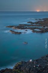 The Next Victim (stuckinparadise) Tags: longexposure cliff lighthouse rock dawn fishing lowlight fishermen dusk powerplant mauritius albion ilemaurice pointeauxcaves stuckinparadise