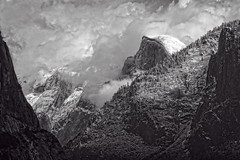 Half Dome With Snow Clouds (stephencurtin) Tags: california trees blackandwhite usa snow clouds photograph valley yosemite dome half snowing drama thechallengefactory