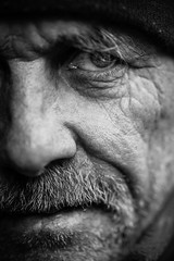 Half face at full intensity (Giulio Magnifico) Tags: lighting old inspiration man black detail macro eye look closeup composition contrast hope alone power emotion expression live character homeless bad citylife thoughtful streetphotography streetportrait sharp thoughts elder half aged gaze glance clochard glacial udine nikond800e nikkormicro105mmafsvrf28