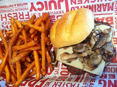 My mushroom & Swiss burger, and sweet potato fries YUM! (f l a m i n g o) Tags: mushroom restaurant burger fastfood iphone smashburger