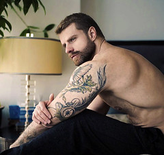 1289 (rrttrrtt555) Tags: hair hairy tattoo beard stare eyes muscles arms armpit shoulders lamp lounge sitting towel bed bedroom masculine