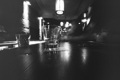 untitled-43-Edit (dvlmnkillatron) Tags: selfdeveloped zero image 69 120 bw film ilford mediumformat pinhole zero69 zeroimage longexposure champaign sevensaints bar whiskey