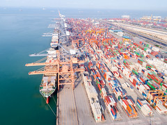 DJI_0009 (Mangpink) Tags: port ship shipping loading industry import industrial storage terminal unloading vessel water truck transportation trade transport harbor sea crane delivery container commerce boat cargo dock business freight export lift high logistics harbour global dusk frame freighters machine manufacturing thailand town warehouses work technology structure pier shipyard sky construction bangkok city international blue customs ocean nautical logistic maritime merchandise economy equipment bulk warehouse large goods heavy carrying carrier commercial