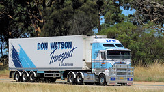 Don WATSON Transport pairing. Hume Highway. (Jungle Jack Movements) Tags: don watson transport coldstores cold fridge refrigerated blue white hume highway freeway livery kenworth mack bulldog burley griffin way bacchus marsh wodonga sydney nsw australia australian new south wales victoria truck tractor prime mover diesel motor engine driver cab cabin fast brake forward reverse wheel exhaust rumble beast registered paint hood litre cubic inches hp horsepower gear haul haulage freight cabover trucker drive carry carrying moving shipping delivery bulk lorry hgv wagon road thermo king