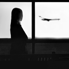 """Independent"" (helmet13) Tags: bw woman window silhouette airplane airport snapshot holidayseason iphone aoi 200faves peaceaward heartaward platinumheartaward world100f bestcapturesaoi"
