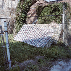 (Lesley Rivera) Tags: city light color 120 film grass fence kodak baltimore medium format portra matress