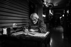 Sudoku in osteria (Giulio Magnifico) Tags: lighting me dark beard table wine reader sudoku friendly osteria udine nikond800e sigma35mmf14dghsm vision:sky=0569