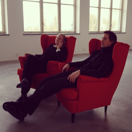 Trying out the new armchairs in an otherwise completely empty living-room. Very comfy.