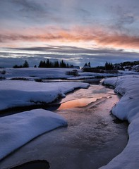 Snowy sunset (andyhainesphotography) Tags: pink winter sunset red snow cold reflection ice water beautiful landscape iceland afternoon awesome january freezing thingvellir deepsnow pingvellir 2011