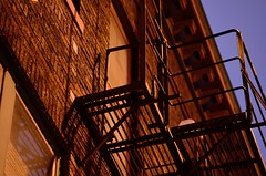 Fire escape # 16 (jimmiesp) Tags: old city winter cold color building skyline architecture night dark lights lowlight alley nikon day cityscape shadows exterior cityscapes stpaul 85mm architectural sidewalk lowkey stpaulmn d5100