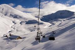 Appesi a un filo (albi_tai) Tags: mountain snow montagne olympus neve sci trentino dolomiti filo baita valdifassa seggiovia pozzadifassa valsannicol olympussp510uz albitai vision:mountain=0919 vision:sky=0916 vision:outdoor=0961 vision:car=0599 vision:clouds=0964 vision:snow=0796