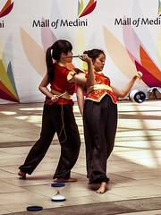 Two street dancer girls (hastuwi) Tags: vacation portrait holiday motion festival festive geotagged action chinesenewyear cny malaysia johor imlek libur liburan yearofthehorse sincia tahunbarucina mallofmedini