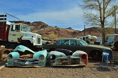 Here in My Car / Where the Image Breaks Down (rickele) Tags: cars truck desert nevada plymouth jaguar fleamarket beatty xj6 junkstore autobodyparts usroute95