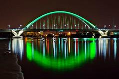 Lowry Green (Doug Wallick) Tags: bridge reflection green ice water minnesota skyline river mississippi day minneapolis stpatricks lowry lightroom a55 mygearandme