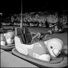 Blackpool Dodgem (Steve U) Tags: england bw white holiday black west 1 pier football seaside fuji ride fairground north central fair lancashire american pro blackpool pro1 18mm footballer dodgem
