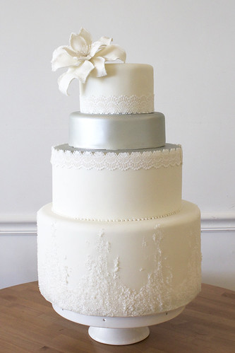 Frosty White and Silver Wedding Cake with with Sugar Frost and Lily Flower